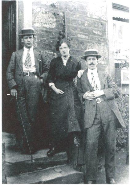 Two Gentlemen And Lady Standing On Doorstep c.1912