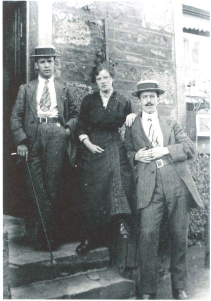 Two Gentlemen And Lady Standing On Doorstep c.1912