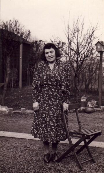 Woman Standing By Chair In Garden At 11 Oakbank Rows, Oakbank, Mid Calder c.1941