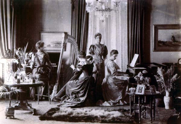 Family Playing Music Together In The Drawing Room c.1900