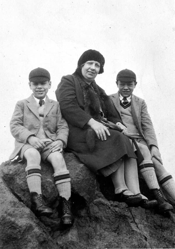 Mother With Two Of Her Sons Sitting On Rock c.1933