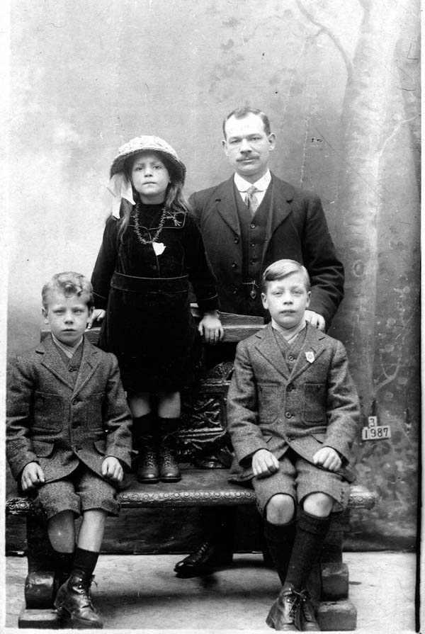 Studio Portrait Father With Two Sons And Daughter c.1917