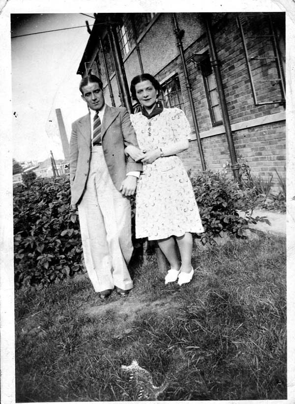 Couple Standing Arm In Arm In The Back Garden 1946
