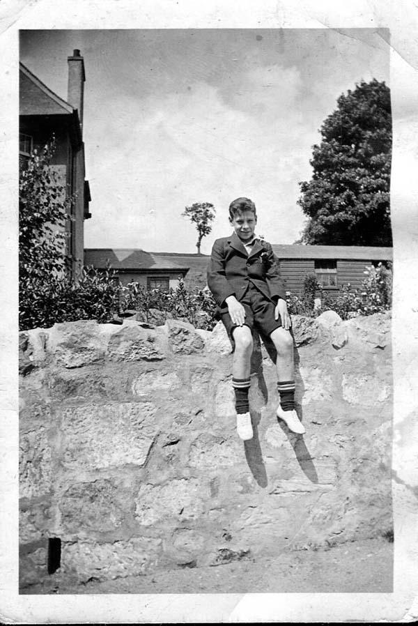 Schoolboy Sitting On Wall 1936