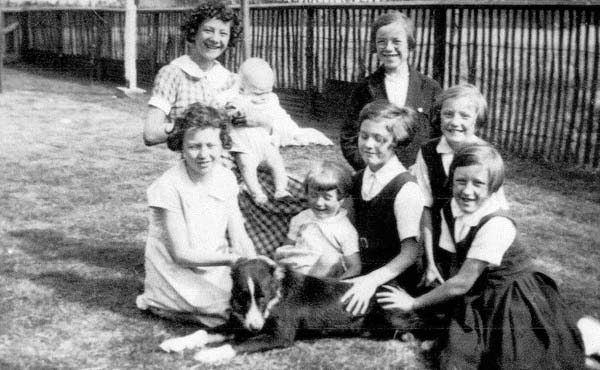 Children Sitting Round Dog In Back Garden 1935