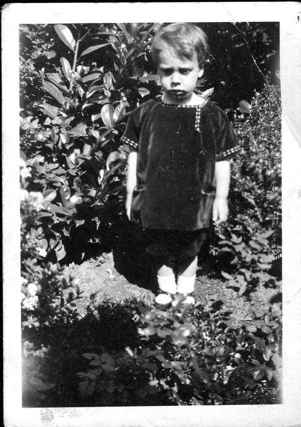 Young Boy Standing In Flower Bed 1924