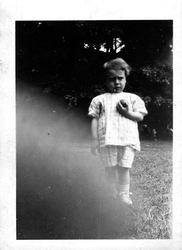 Young Boy Standing With Ball In Park 1924