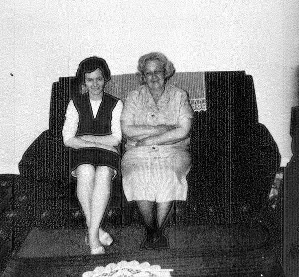 Mother And Daughter Sitting Together On The Sofa 1968