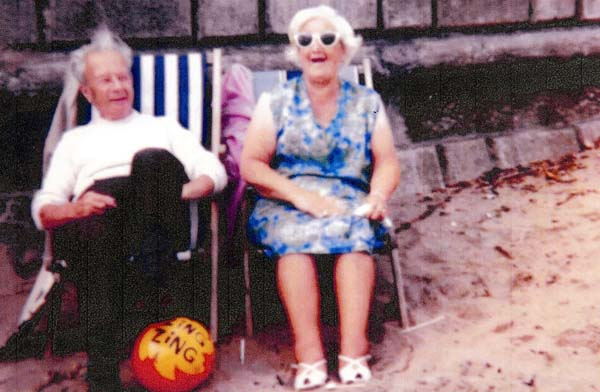 Elderly Couple On Holiday At The Beach 1960s