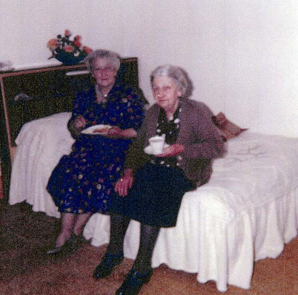 Two Women Sitting Having A Cup of Tea On The Bed At Home In Bangor Road c.1965