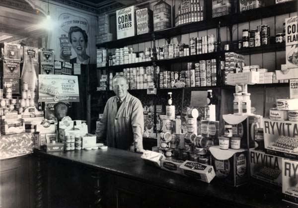 Grocer At Counter Of His Store In Dalry 1950s