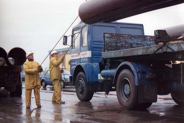 Dockers Transporting Pipes 1980s
