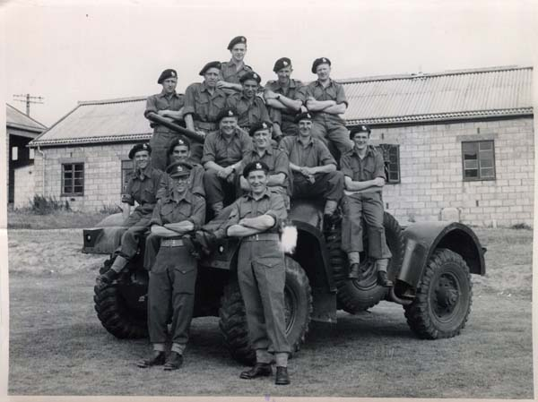 Squad Of Soldiers On Top Of Vehicle 1940s