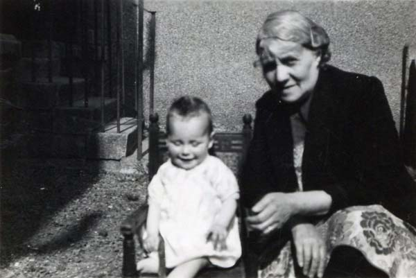 Woman And Young Child Seated At Back Of House c.1955