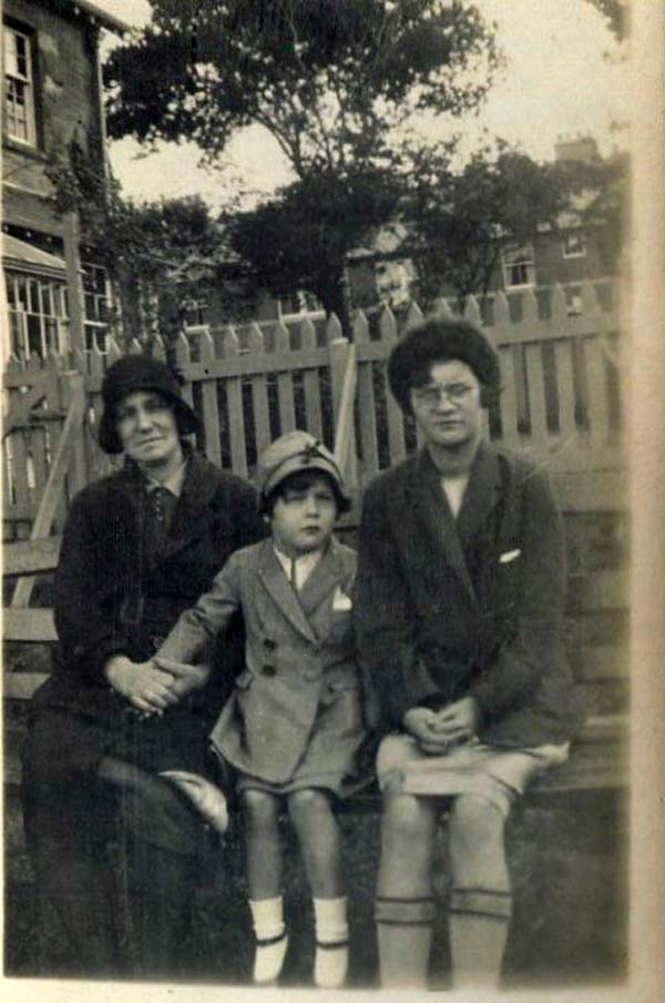 Woman And Children Sitting On Bench 1930s