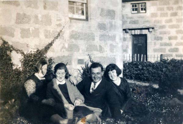Group Of Friends Sitting In The Garden 1930s