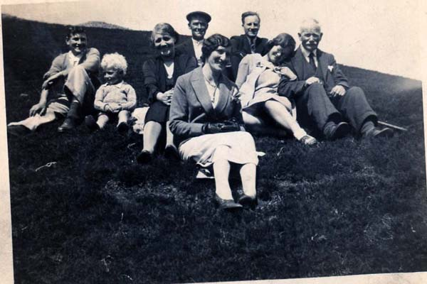 Family Group Sitting On Hillside 1930s