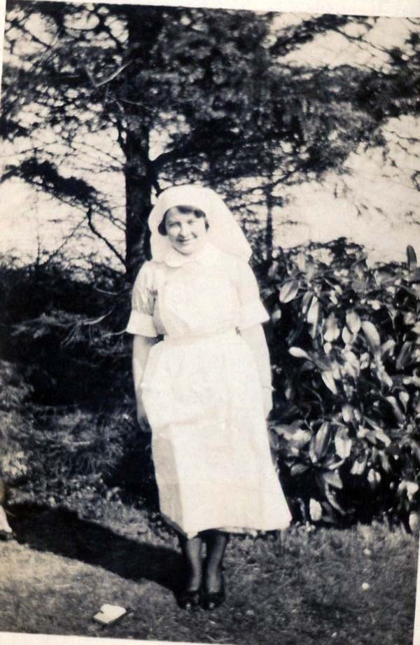 Nurse In Garden Leaning Into The Wind 1930s