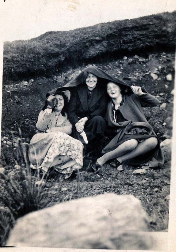 Women Taking Shelter On A Hillside 1930s