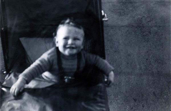 Smiling Toddler In Pram 1930s