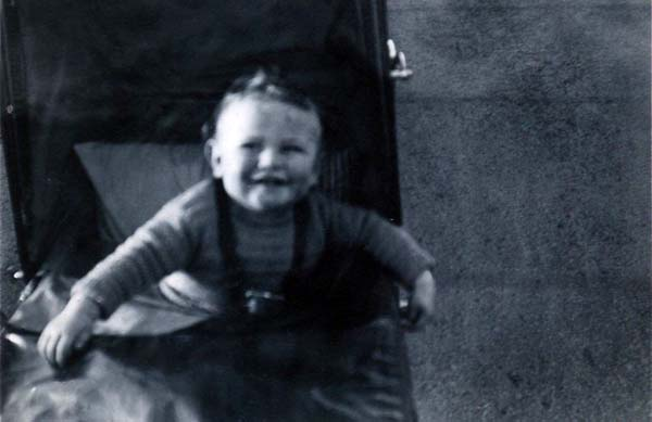 Smiling Toddler In Pram 1930s
