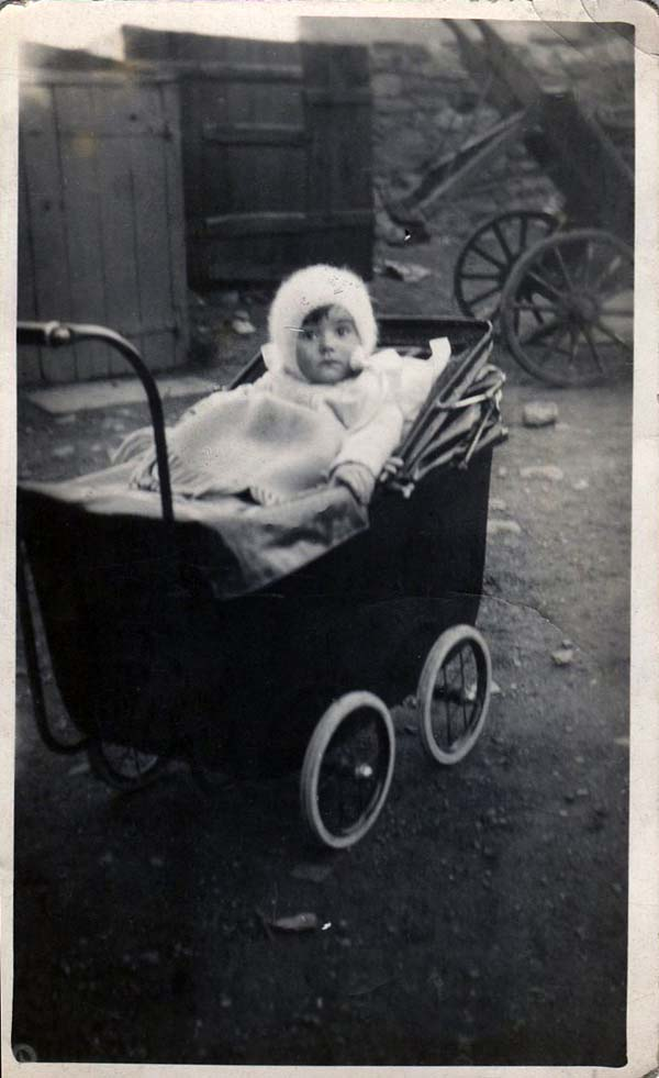 Young Child Sitting In Pram 1930s