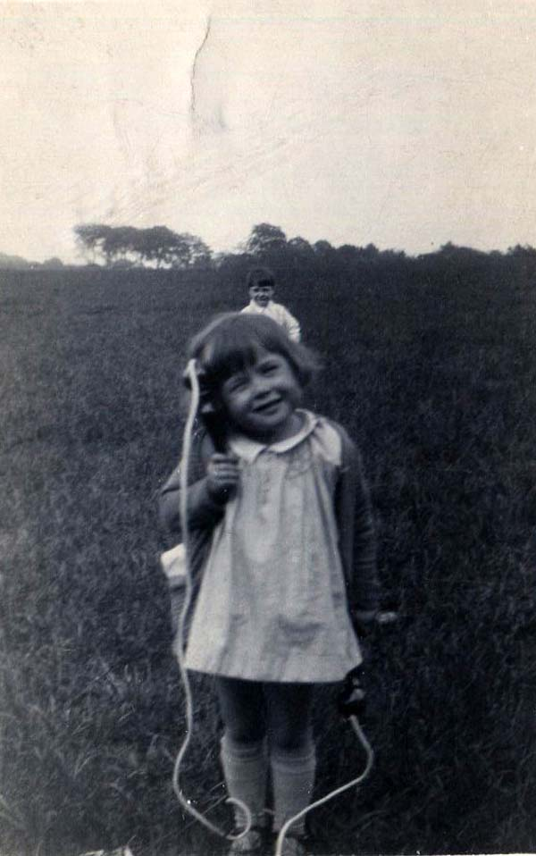 Young Girl Skipping In Field 1930s