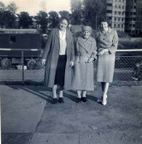 Three Women Standing On Platform 1950s