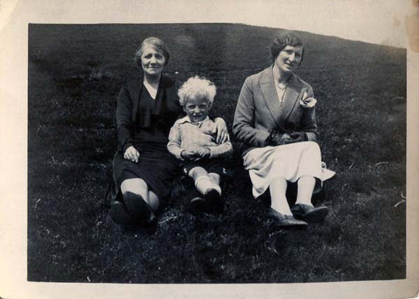 Two Women And Young Boy Sitting On A Hillside 1930s