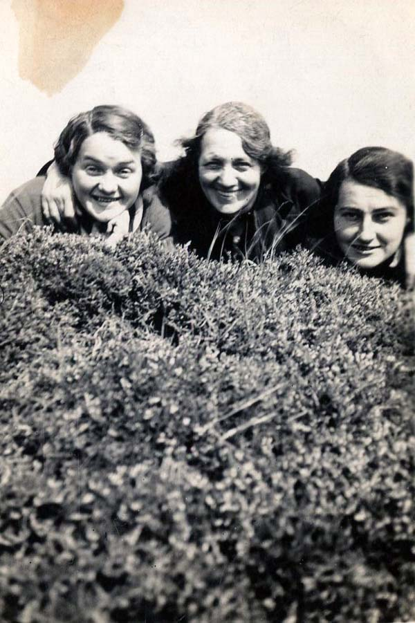 Three Women Peeking Heads Over The Heather 1930s