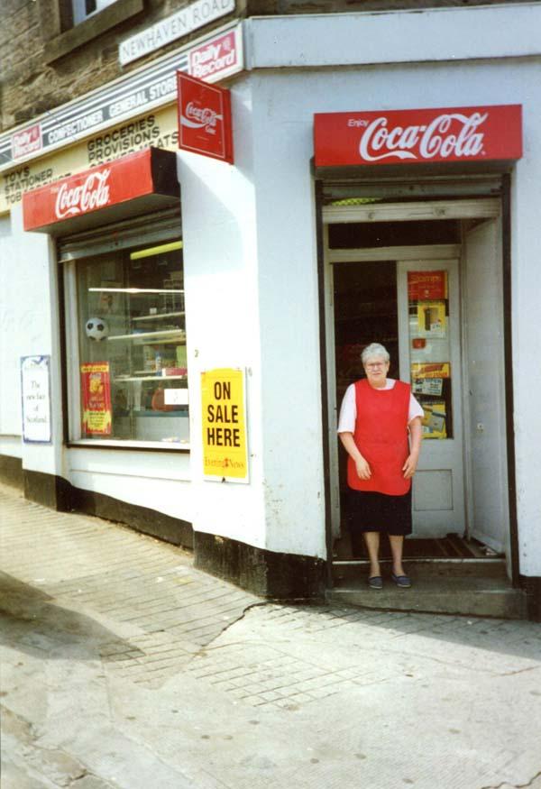 Shop Assistant Standing Outside Corner Shop Door, early 1990s