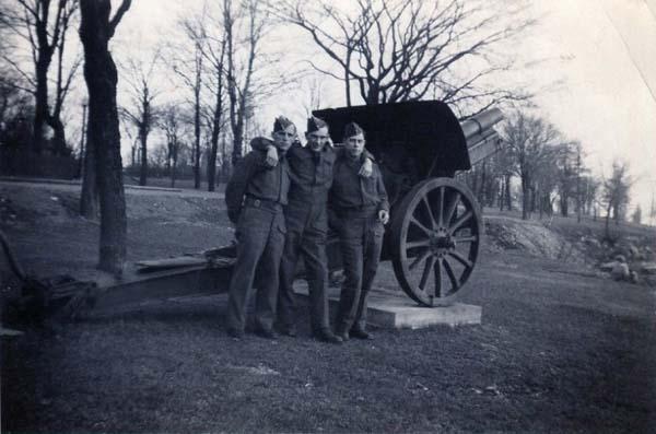 Three Soldiers Standing By Artillery Gun 1940s