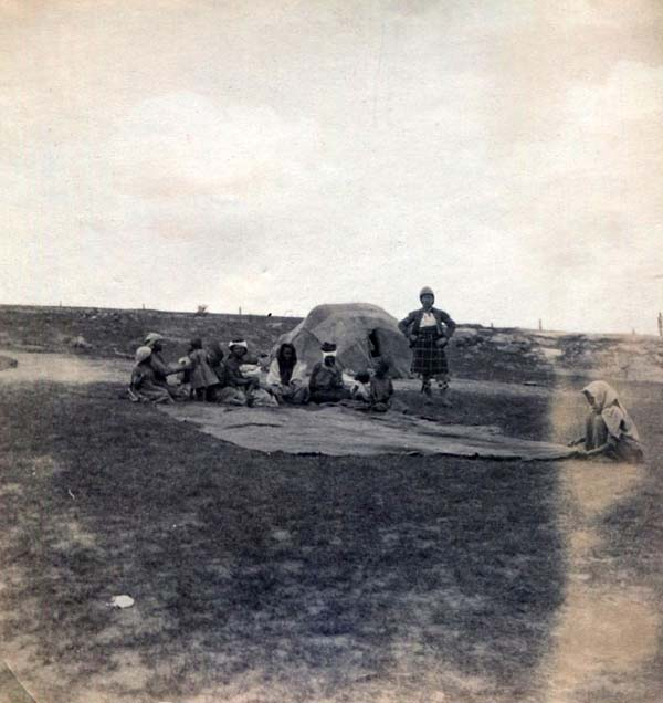 Soldier Standing On Plain With Local Tribes People, Boer War 1899-1902