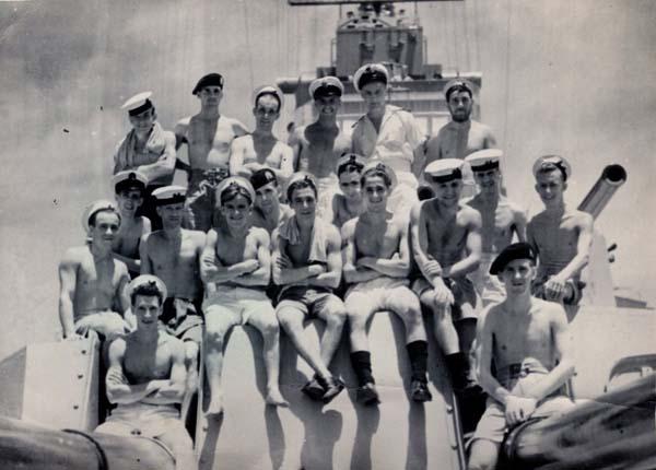 Sailors Sitting On Battleship Gun Turret 1942