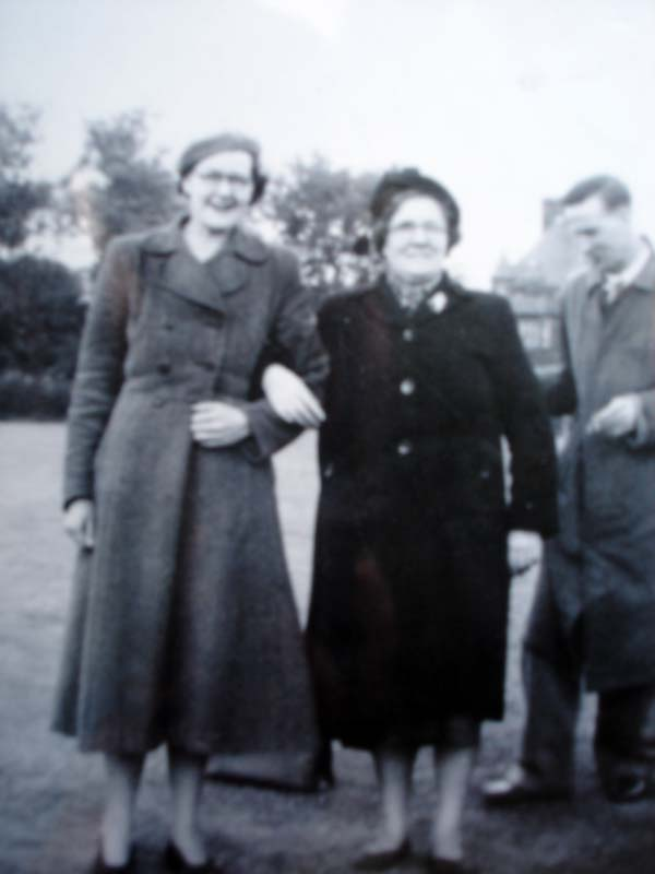 Two Women And A Man In Coats 1950s