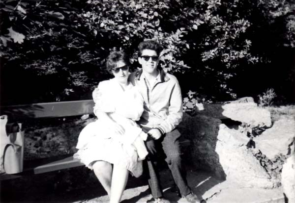 Couple On Holiday Sitting On Bench 1964