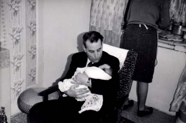 Grandfather Sitting In Armchair Holding His Baby Granddaughter 1966