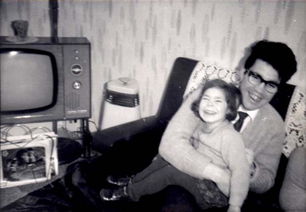 Father And Daughter Sitting On Sofa In The Living Room c.1969