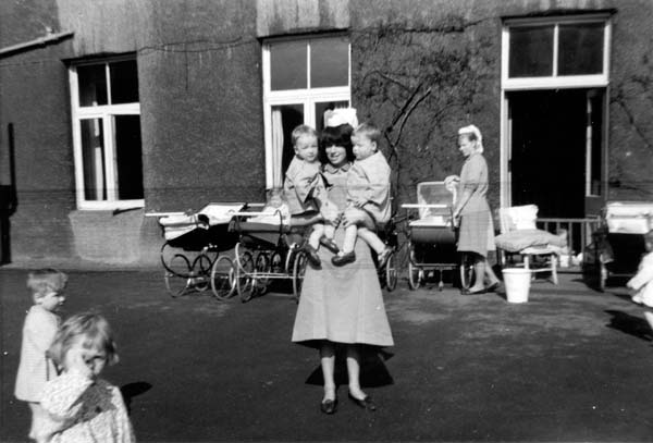 Nursery Nurse Holding Two Of Her Charges 1960s