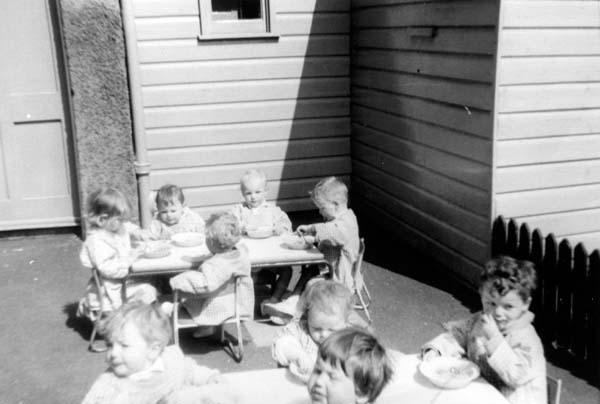 Nursery Children Eating Outdoor In The Sun 1960s