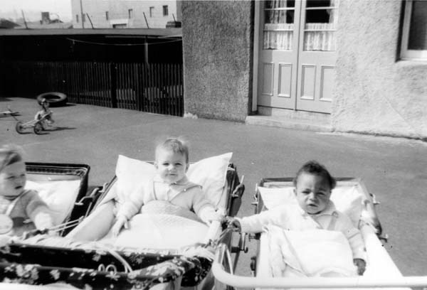 Three Nursery Children In Prams 1960s