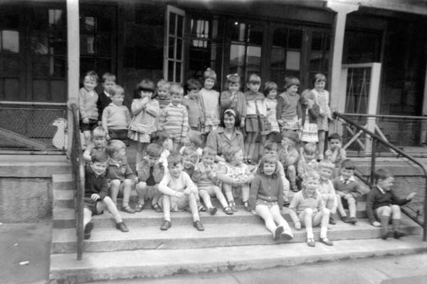 Childcarer With Group Of Children At Nursery School 1960s
