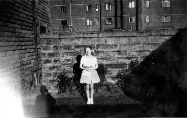 Girl Having Her Picture Taken In The Back Garden c.1960
