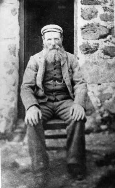 Man Sitting In Front Of Crofthouse 1913