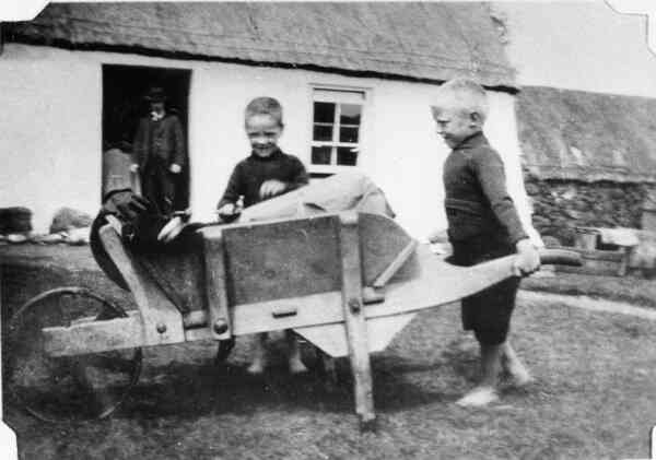 Two Young Boys Playing With Wheelbarrow c.1911