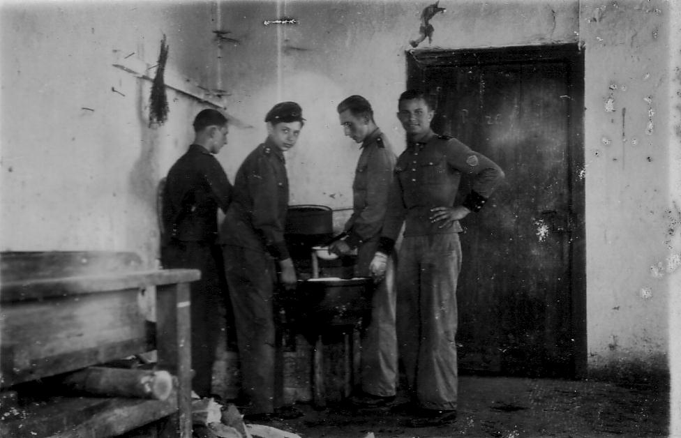 Group Of Polish Soldiers Standing Round Pot While On Retreat c.1940