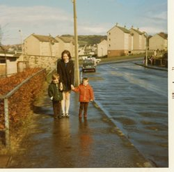 Family standing in Oxgangs Farm Drive