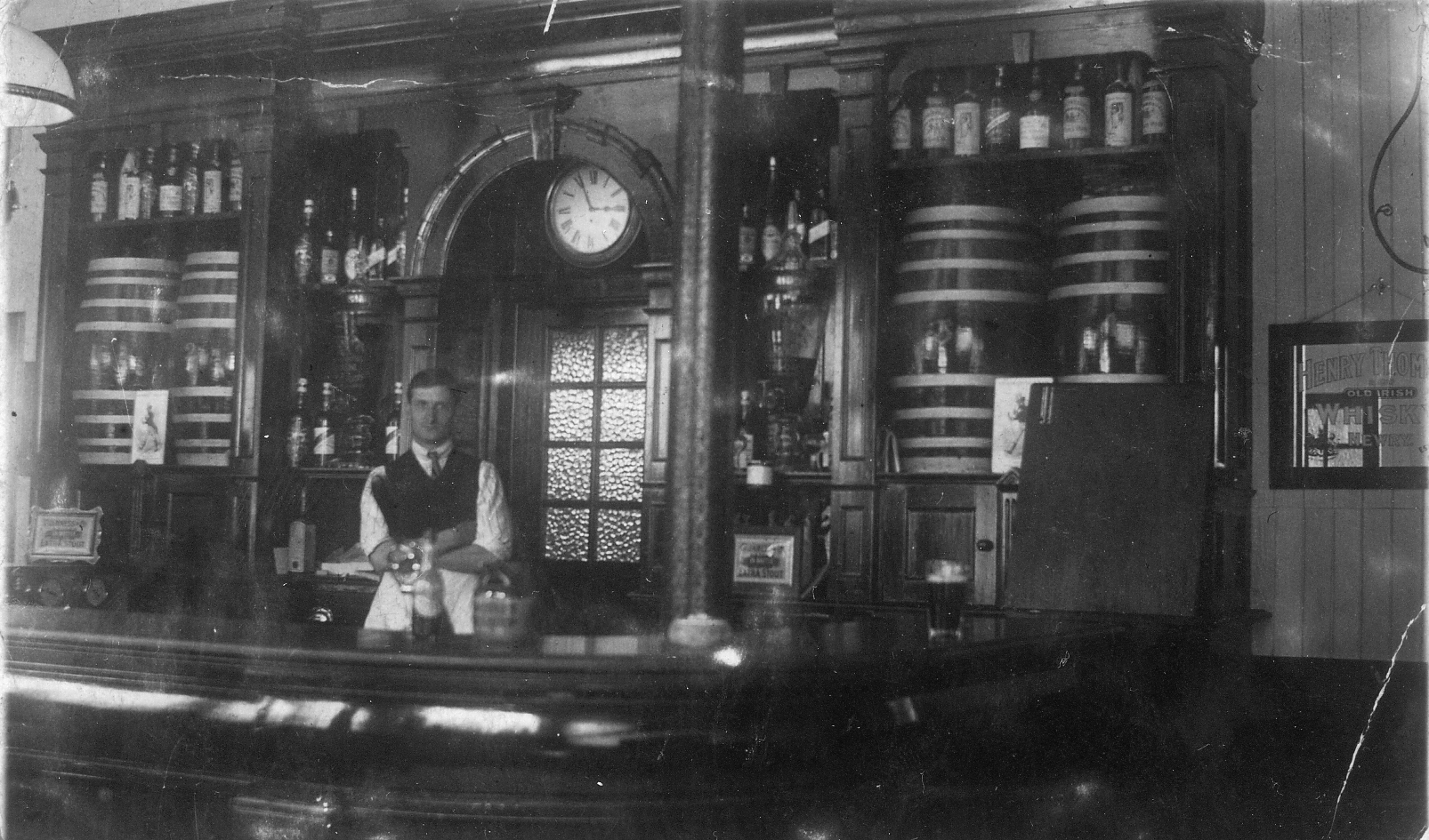 Barman Standing Behind The Bar c.1910