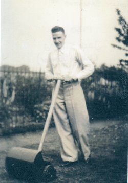 Young Man Mowing The Lawn 1930