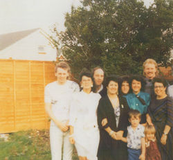 This is a photo of my Brother George with his Family.